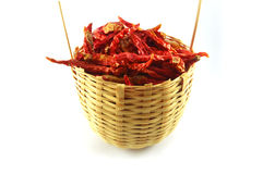Pepper in basket. Dry red pepper in basket on white background Stock Images