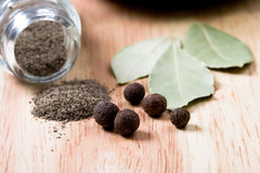 Pepper and bay leaves Stock Photography