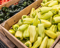 Pepper bins. Wooden bins of yellow and green peppers at the Clement Street Farmer's Market in San Francisco Stock Photo