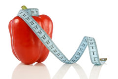 Pepper with a blue measuring tape. Stock Image