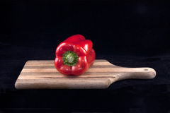 Pepper on a board. Stock Photography