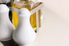 Pepper bottle on the kitchen table for your meal. Stock Images