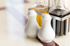 Pepper bottle on the kitchen table for your meal. Stock Photo