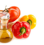 Pepper and a bottle with olive oil Stock Images