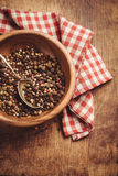 Pepper in a bowl on the table and kitchen towel Stock Image
