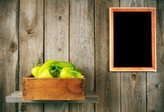 Pepper in a box, and  framework. Royalty Free Stock Photos