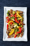 Pepper broccoli beef stir fry. On a dark background. the toning. selective focus Stock Image