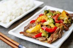 Pepper broccoli beef stir fry Stock Photo