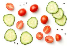 Pepper Cherry Tomatoes with Cucumber Isolated on White Backgroun. Red pepper cherry tomatoes with cucumber and peppercorn isolated on white background. Top view Stock Image