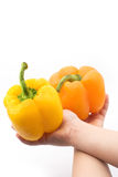 Pepper in children's hands. Bulgarian pepper in children's hands on a white background Royalty Free Stock Photos