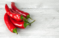 Pepper chili on grey wooden board Royalty Free Stock Image