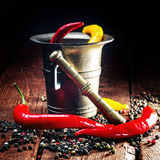 Pepper , chili and mortar Stock Photos