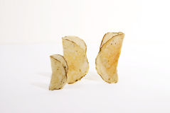 The pepper chips family. Three salt and pepper chips standing on a white background Stock Image