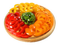 Pepper on the chopping board. (isolated). Red yellow orange green pepper on the chopping board. (isolated Stock Image