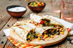 Pepper corn black bean quinoa burritos Royalty Free Stock Images