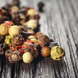 Pepper corns. On a wooden board Stock Images