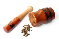 Pepper corns and wooden mortar Stock Images