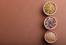Pepper,cumin,paprika in a wooden bowl Stock Image