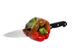 Pepper cut with knife royalty free stock photo