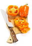Pepper on a cutting board. And knife Stock Images