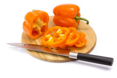 Pepper on a cutting board. And knife Stock Photography