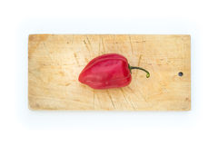 Pepper on cutting board Stock Photo