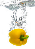 Pepper dropped in water stock photography