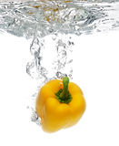 Pepper dropped in water Royalty Free Stock Photos