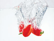 Pepper. Falling in the water Stock Image