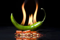 Pepper on fire Stock Photo