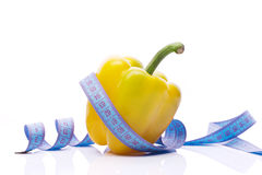 Pepper and fitness. Sweet yellow pepper with measuring tape Stock Images