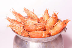 Pepper fried with freshwater giant prawns on hot stew in Mekong Royalty Free Stock Photography