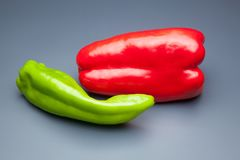 Pepper full of vitamins. Red pepper and green pepper, ingredient for cooking and also for use in salads; It is usually used to make stir-fry, sauces, it is a stock photography
