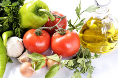 Pepper, garlic, onion, tomatoes and oil Royalty Free Stock Image