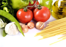 Pepper, garlic, onion, tomatoes and oil Stock Photography