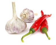 Pepper and garlic on white Royalty Free Stock Photography
