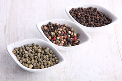 Pepper grains in bowls Royalty Free Stock Photo