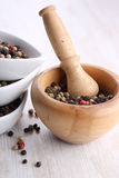 Pepper grains in bowls Stock Images