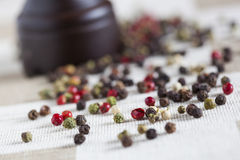 Pepper grains and grinder Stock Photos