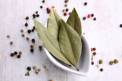 Pepper grains and leaves in bowls Royalty Free Stock Photography