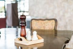 Pepper grinder and saltshaker. On the table royalty free stock images
