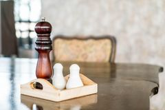Pepper grinder and saltshaker. On the table stock image