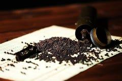 Pepper grinder. Vintage manual pepper grinder on a wooden background Royalty Free Stock Photo