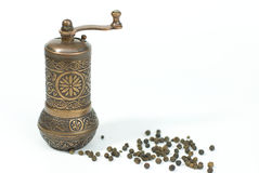 Pepper Grinder With Pepper Grains Stock Photos