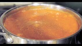 Pepper grinding in tomato sauce stock footage