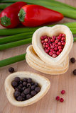 Pepper heart. Heart with red and black pepper Stock Photo