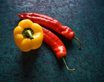 Pepper jellow and red. On a green background stock photos