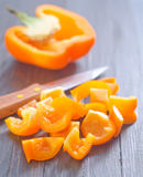 Pepper  and knife Stock Images