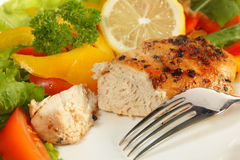 Pepper lemon chicken breast and salad Stock Image