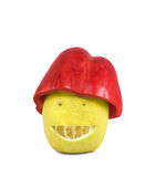 Pepper lemon smile. Smiling lemon and red sweet pepper as a hat Royalty Free Stock Photos